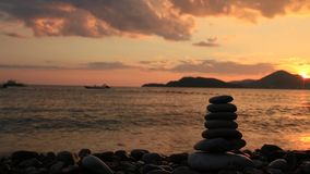 Balance stones on the beach. Peace of mind. Equilibrium life. Ca stock video
