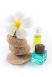 The balance stones with Frangipani flower, shampoo Royalty Free Stock Photo