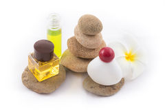 The balance stones with Frangipani flower, shampoo. The isolated of the balance stones with Frangipani flower and shampoo is zen for spa on white background Stock Photography