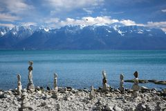 Stones balance on the lake with views of the mountains Stock Photos