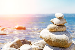 Balance. Stones balance, pebbles stack over blue sea royalty free stock photos