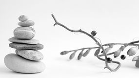 Balance of stones. Stones for spa treatments on a white background. The concept of meditation in the stones is stacked in stock photo
