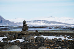 Balance stones stacked, Landscape in winter, zen-like, calmness concept Stock Photography