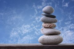 Balance Stones stacked to pyramid in the blue sky background. Royalty Free Stock Image