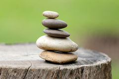 Balance Stones stacked to pyramid in the soft green background. Stock Photos