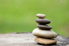 Balance Stones stacked to pyramid in the soft green background. Stock Photo