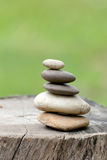 Balance Stones stacked to pyramid in the soft green background. Royalty Free Stock Photos
