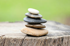 Balance Stones stacked to pyramid in the soft green background. Royalty Free Stock Images