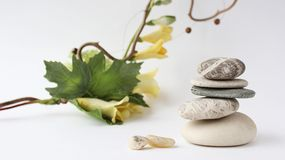 Balance of stones. Stones for spa treatments on a white backgrou Royalty Free Stock Photos