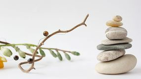 Balance of stones. Stones for spa treatments on a white backgrou. Nd. The concept of meditation in the stones is stacked in pyramid.r royalty free stock photography