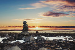 Balance stones, Zen stone stacked, with blurred sunset background Royalty Free Stock Photo