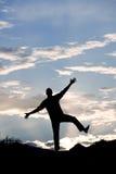 Balance of Strength. A young man performing a balance pose Stock Photography