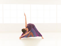Balance and stretching yoga pose demonstration Royalty Free Stock Photography