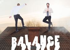 Balance text and Businessmen balancing on Roof with chimney and trees in evening light. Digital composite of Balance text and Businessmen balancing on Roof with Royalty Free Stock Images
