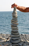 Balance in the tower of the sea stones Stock Photos
