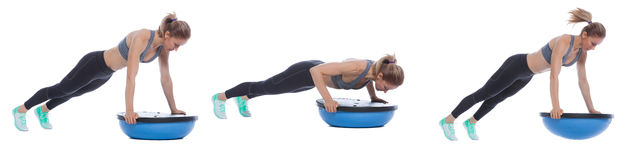 Balance training ball exercise. Execution with a professional trainer Royalty Free Stock Photos