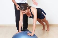 Balance training. Physical therapist explaining balance training Stock Images