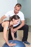 Balance training on platform with coach Royalty Free Stock Images