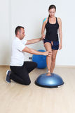 Balance training on platform with coach Stock Photography