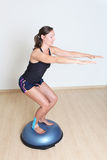 Balance training on platform Stock Photography