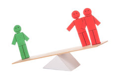 Balance of two coloured toy men Royalty Free Stock Images