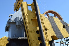 Balance weight and reducer  pumping unit of an oil well. Royalty Free Stock Photos