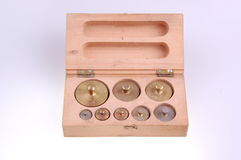 Balance weights in wooden box Royalty Free Stock Photo