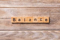 Balance word written on wood block. balance text on wooden table for your desing, concept royalty free stock photography