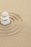 Balance zen stone in sand with circles Royalty Free Stock Image