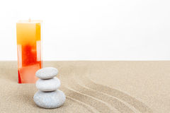 Balance zen stones and candle in sand on white Royalty Free Stock Photos