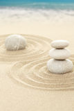Balance zen stones in sand with sea Royalty Free Stock Images