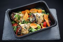 Balanced box diet, grilled aubergine rolls with vegetables royalty free stock photography
