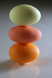 Balanced candy eggs Royalty Free Stock Photo