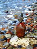Balanced colorful stack of Stones on the coast stock photo