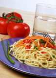A Balanced Diet. A fresh healty meal of noodles, carrots, and tomatoes Stock Photo