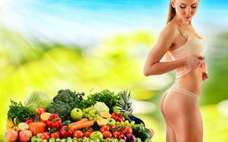 Balanced diet based on raw organic vegetables and fruits Royalty Free Stock Photos