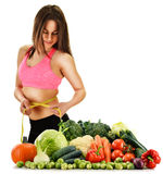 Balanced diet based on raw organic vegetables and fruits. Dieting. Balanced diet based on raw organic vegetables and fruits Royalty Free Stock Photography