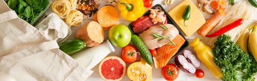 Balanced diet concept - fresh meat, fish, pasta, fruits and vegetables, nuts, seeds stock image