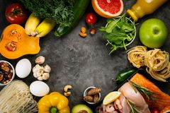Balanced diet concept - fresh meat, fish, pasta, fruits and vegetables, nuts, seeds royalty free stock images