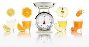 Balanced diet concept. weight scales and fruit juices in glass i. Solated on white background Royalty Free Stock Photos
