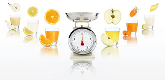 Balanced diet concept. weight scales with fruits juice glass is Stock Photo