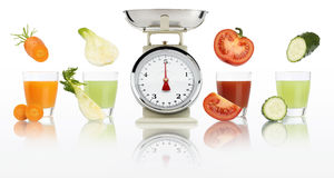 Balanced diet concept. weight scales and Vegetable juices in gla Royalty Free Stock Photography