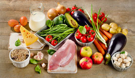 Balanced diet, cooking and healthy food concept on wooden table. View from above Stock Photos