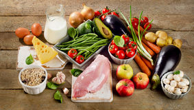 Balanced diet, cooking and organic food concept. On rustic wooden table. Top view stock image