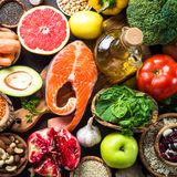 Balanced diet food background. Organic food for healthy nutrition, superfoods. Fish, legumes, nuts, seeds, greens, oil and vegetables Top view royalty free stock image