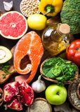 Balanced diet food background. Organic food for healthy nutrition, superfoods. Fish, legumes,  nuts, seeds, greens, oil and vegetables Top view Royalty Free Stock Images