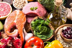 Balanced diet food background. Organic food for healthy nutrition, superfoods. Meat, fish, legumes,  nuts, seeds, greens oil and vegetables Royalty Free Stock Images