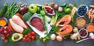 Balanced diet food background. Organic food for healthy nutrition, superfoods, meat, fish, legumes, nuts, seeds and greens royalty free stock image