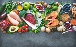 Balanced diet food background. Organic food for healthy nutrition, superfoods, meat, fish, legumes, nuts, seeds and greens royalty free stock photos