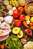 Balanced diet food background. Healthy ingredients on a dark background, top view. Balanced diet food background. Healthy ingredients: fruits, vegetables, meat stock photo